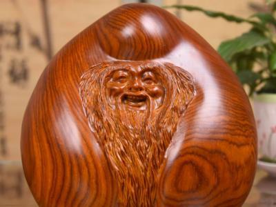 木雕老壽星擺放在家里有哪些寓意象征